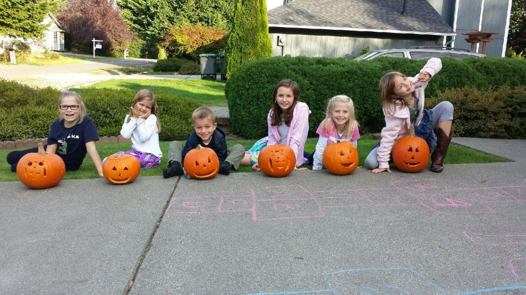Carving pumpkins with 6 kids on the driveway - I have one brave friend!!